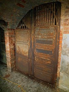 Nearest to the camera is the Manners-Sutton vault in the crypt of All Saints church. The cast iron door bears the names of all five of the Leamington sisters
