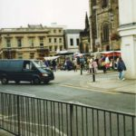 Around 2000: the weekly market in Victoria Terrace outside the Parish Church. Priory Terrace is in the background.