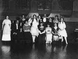 Austin Edwards and family in the Ballroom, 1911