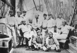 On board the Nova Scotia, bound for Canada and USA. George Parr sits hatless in the middle of the back row. John Wisden reclines on the chair at the left.