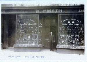 William Smith standing outside his Bath St shop.